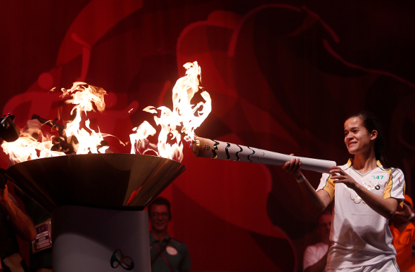 Veronica Hipolito em Sao Jose dos Campos lights the Olympic Flame in Brazil.