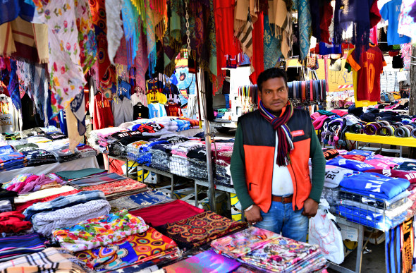 A street market with colourful clothes in Rome