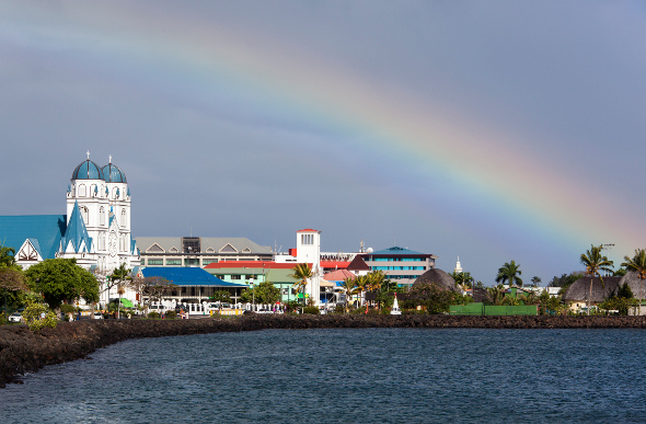 A rainbow rises above the town of Apia in Samoa.
