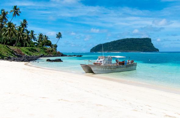A boat at shore on Lalomanu beach