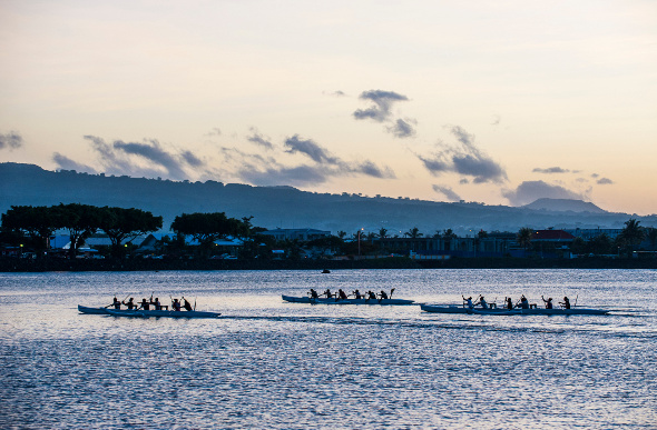 Rowers cruising along the water in Apia