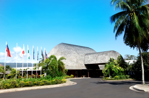 The thatched-roof exterior of the Tano Tusitala Hotel