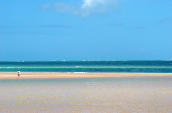 A woman walks the beach on Bazaruto Island.