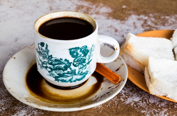 Classical Chinese coffee cup with bread.