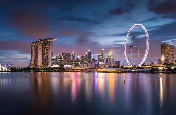 Twilight scene of downtown city skyline along Marina Bay, Singapore.