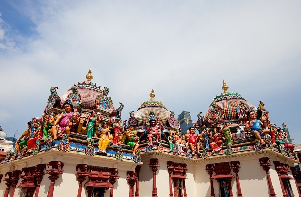 Colourful statues adorn the rooftop temples of Sri Mariamman.