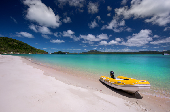 The inviting Chalkies Beach in the Whitsundays has turquoise blue waters, and coral just offshore.