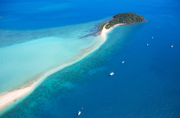 Langford Island beach is a narrow strip of sand among the coral of the Great Barrier Reef in the Whitsundays.