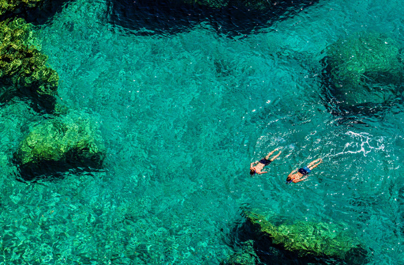 Snorkellers in turquoise water.