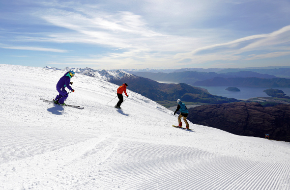 Skiers admire the view at Treble Cone, New Zealand.