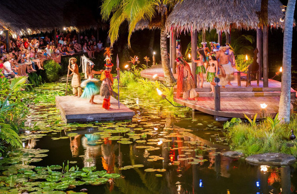 Performers dance on a floating stage at Te Vara Nui village in Rarotonga