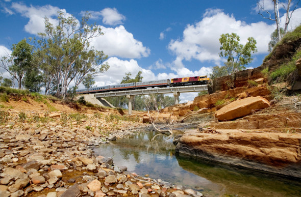 The Spirit of the Outback train crosses a creek in country Queensland