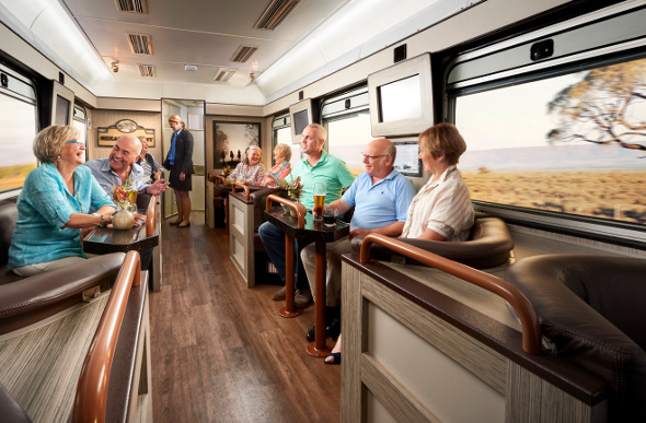 People enjoy a beer and a laugh in the Shearer's Rest lounge car on board the Spirit of the Outback train.