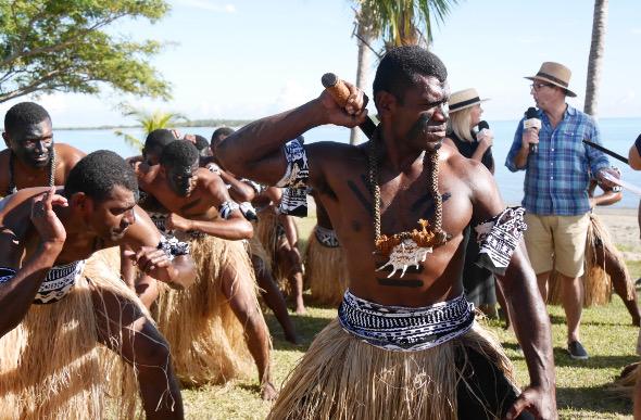 Sam and Kochie report as Fijian warriors dance.