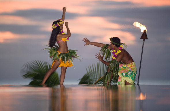 Two dancers perform in Tahiti.
