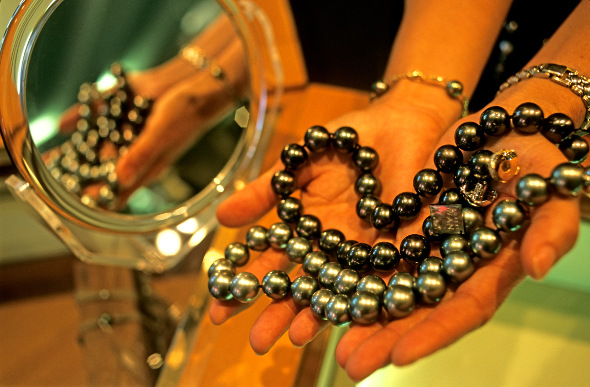 A necklace of black pearls in Tahiti.