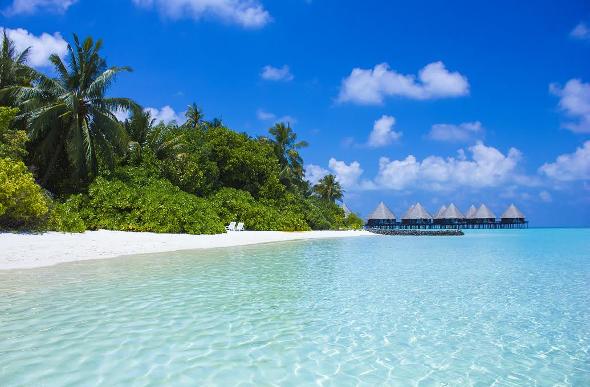 Tahiti bungalows over water.