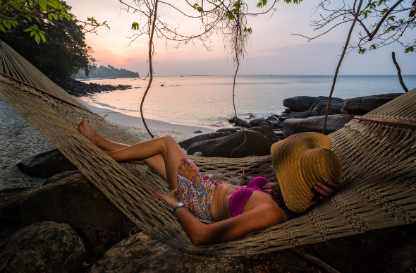 Woman lazing in a hammock on Phi Phi Island