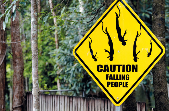 """A sign screams """"Caution falling people"""" at a bungy jumping spot in Cairns."""