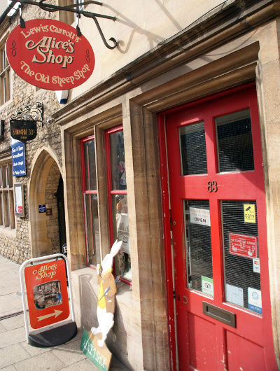 The red door and sign to Alice's Shop in Oxford