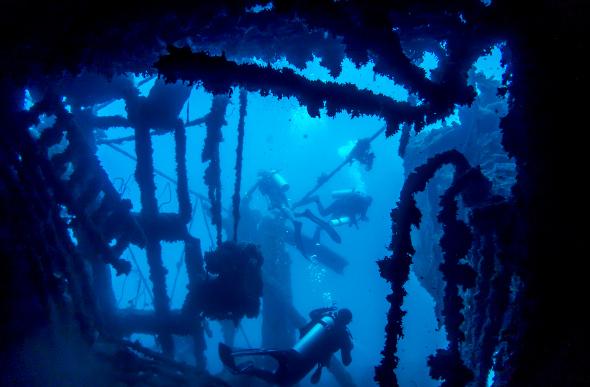 Group of divers exploring President Coolidge wreck in Vanuatu