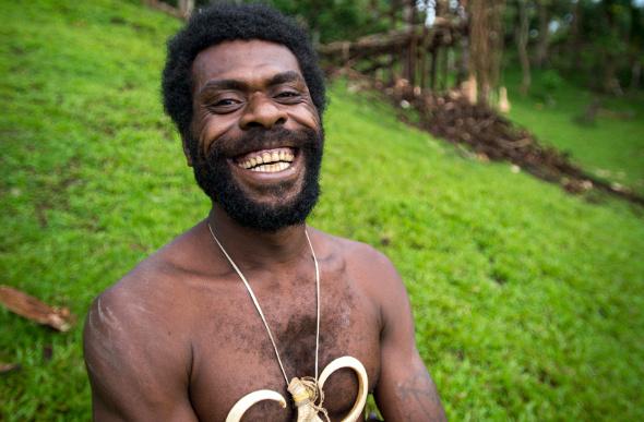 A smiling Ni-Vanuatu man prepares to take part in the land-diving ritual on Pentecost Island in Vanuatu.