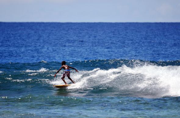 A young Vanuatu boy surfing