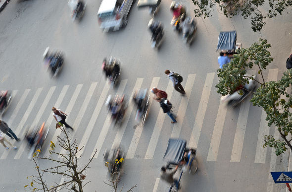 Pedestrians try to cross the road in Ho Chi Minh City, Vietnam.