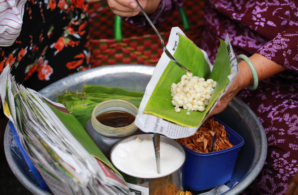 A woman serves street food in Ho Chi Minh City, Vietnam.