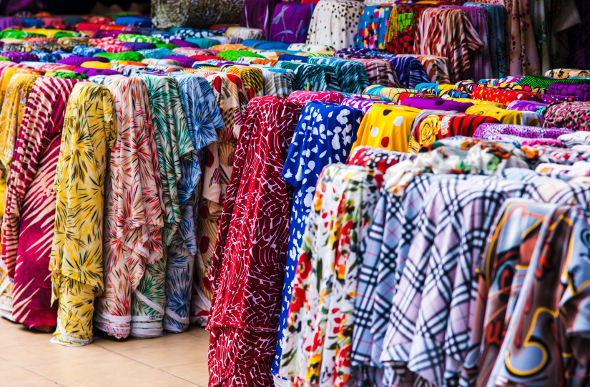 Brightly coloured bolts of fabric for sale at a Ho Chi Minh City market in Vietnam.