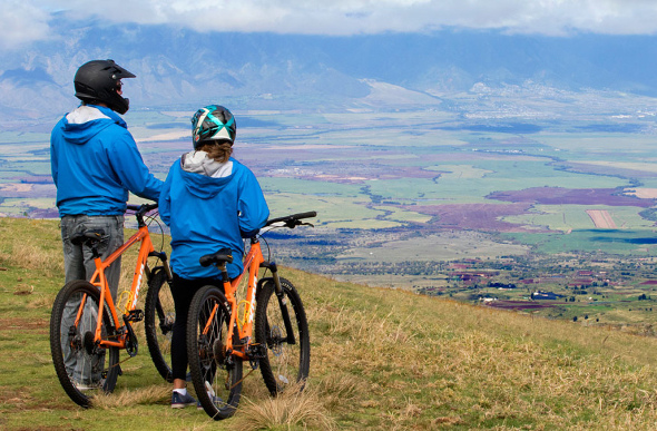 Cyclists at a lookout on Haleakala, Hawaii.