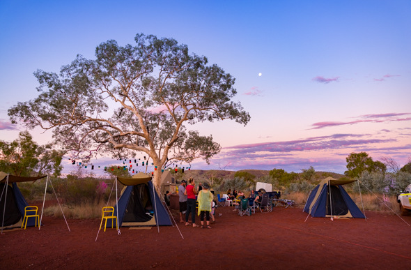 Tents line up beneath fairy lights in Karijini National Park, Western Australia.
