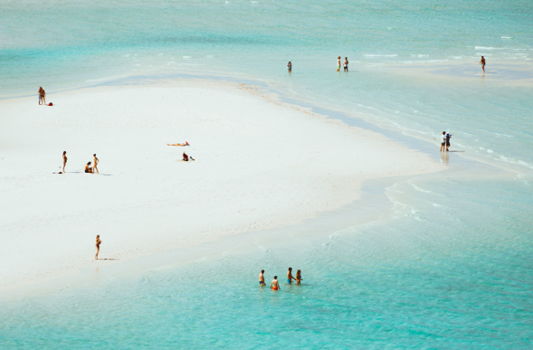 People play in the shallow waters of Hill Inlet in the Whitsundays. Picture: Jason Charles Hill