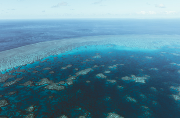 An aerial view of the Great Barrier Reef in the Whitsundays.