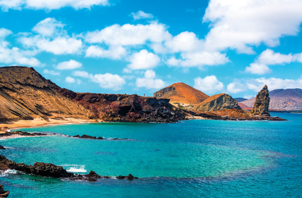 The blue-green waters and barren-looking hillsides of the Galapagos Islands.