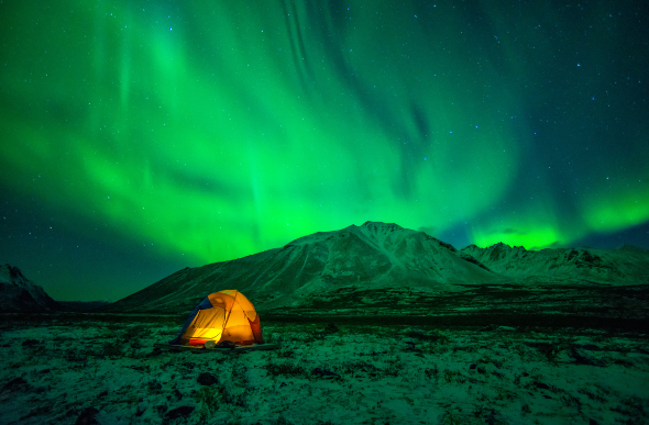 A tent under the northern lights in Yukon