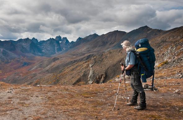 A man hiking along mountains in Yukon