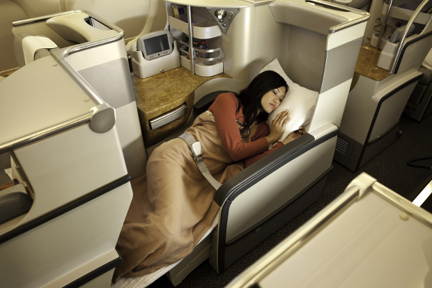 A woman in one of the Business Class lie-flat seats