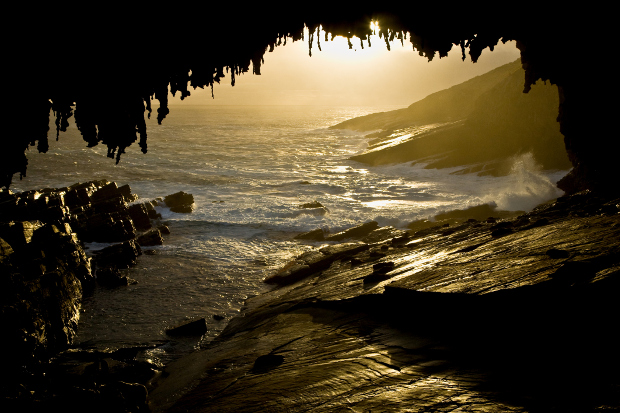 Views looking under Admirals Arch to the Southern Ocean