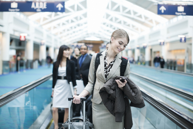 Woman looking at her phone in the airport