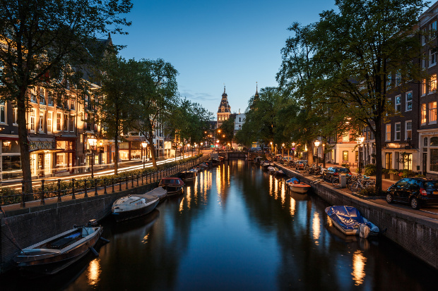 A nighttime view of one of Amsterdam's canals