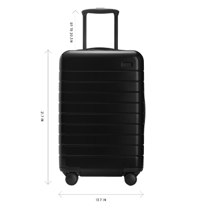 An Away carry-on suitcase with measurements highlighted