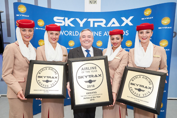 Emirates flight attendants and president holding their awards up at the Skytrax awards