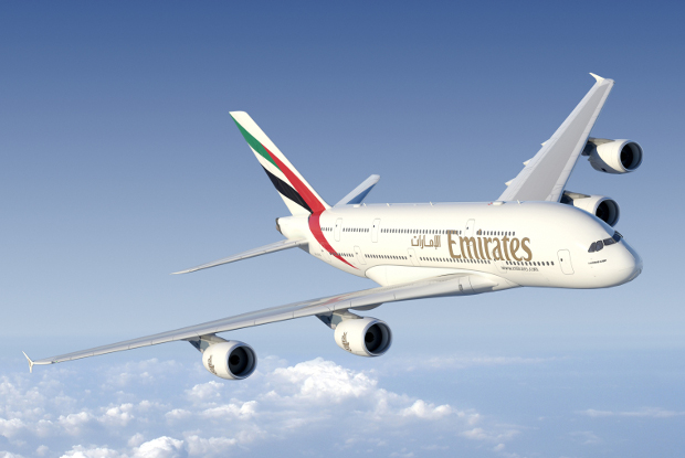 An Emirates A380 flying through the air