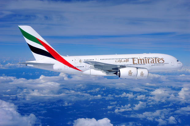 An Emirates A380 flying through the skies