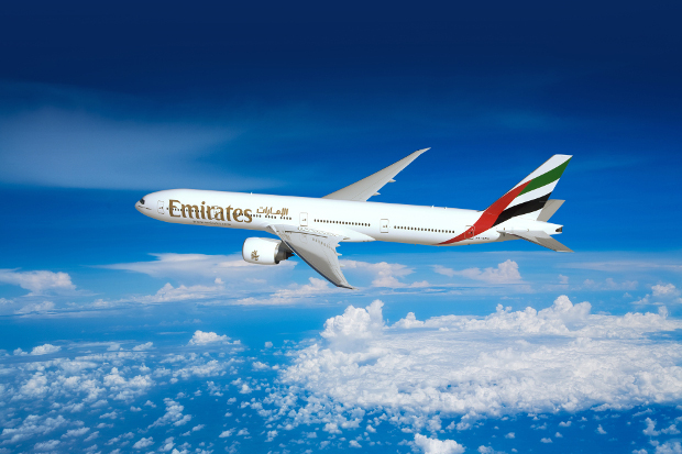 Emirates aircraft flying in the skies