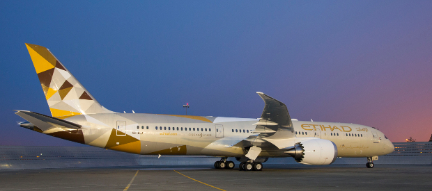 An external view of an Etihad 787 aircraft on the runway at dusk