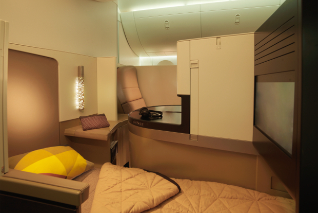 A lie-flat seat in Etihad business class