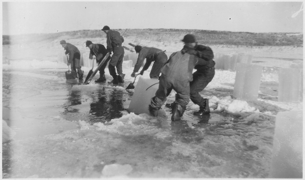 Ice cutters collecting ice from a frozen lake