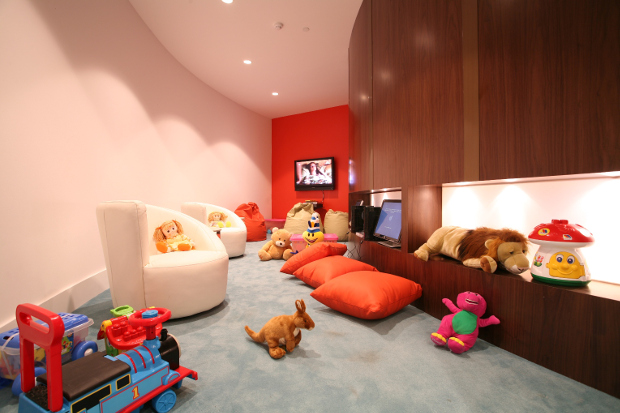A view of the Etihad Family Room with games and toys scattered around